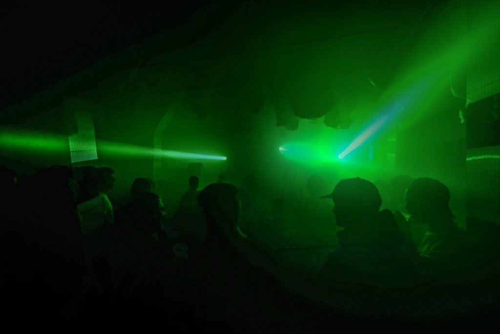 The Chop Shop audience, bathed in green light.